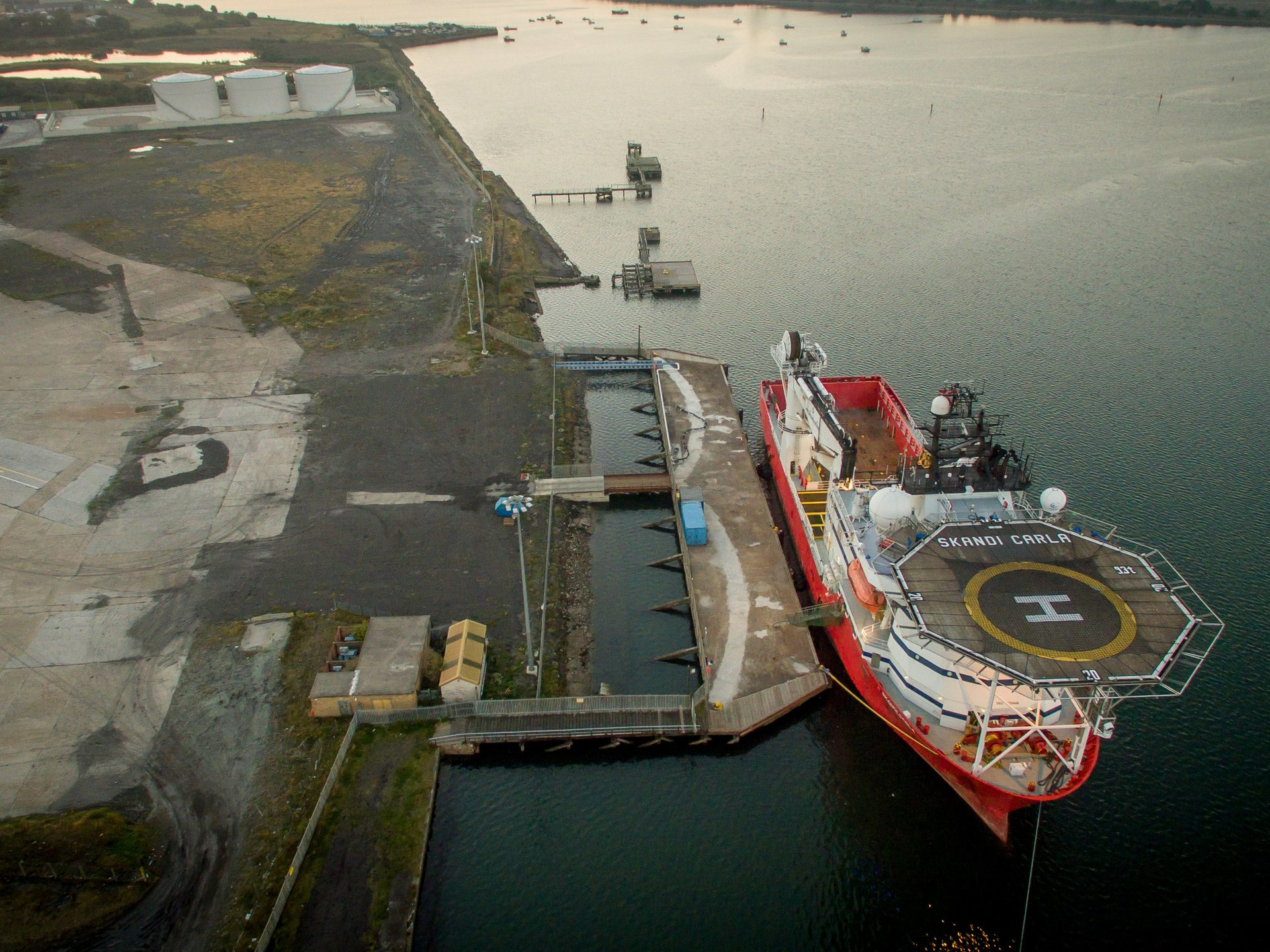 aerial photograph of large marine ship in port from 200ft